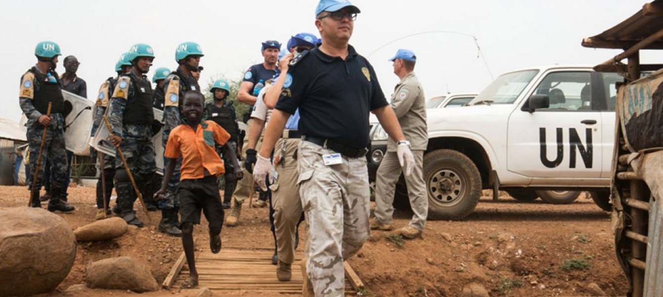 UN Police conducts search operation in Juba Protection of Civilians site, South Sudan. Photo: UNMISS