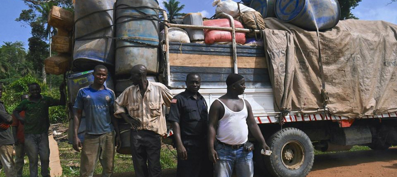 Truckers from Guinea wait to be screened for Ebola at the busy Konadu checkpoint in Lofa County, Liberia.