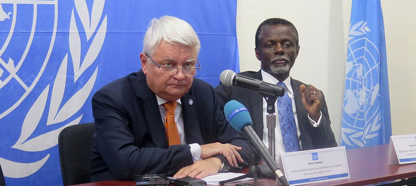 Peacekeeping chief Hervé Ladsous announcing at a press conference that the UN has established a weapons-free zone in the town of Bambari in the Central African Republic (CAR). Special Representative in CAR Parfait Onanga-Anyanga is at right. UN Photo/Bits