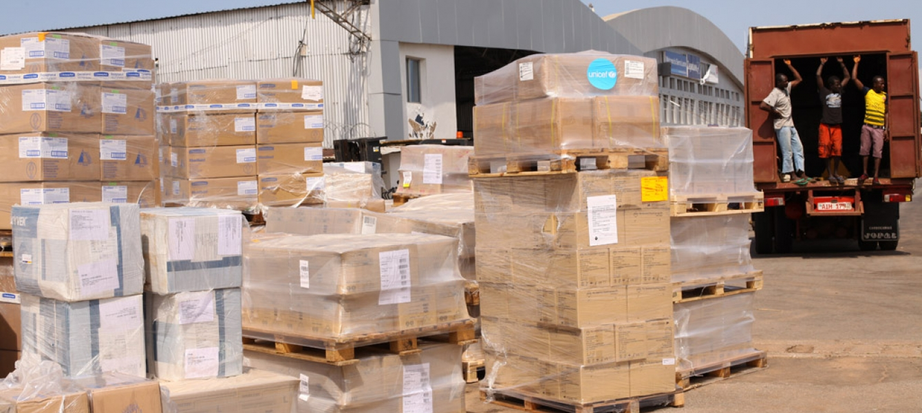 Ebola response: medical supplies, including protective equipment and essential medicine, are loaded onto trucks at the Lungi International Airport in Freetown, capital of Sierra Leone. Photo: UNICEF/Sulaiman Stephens