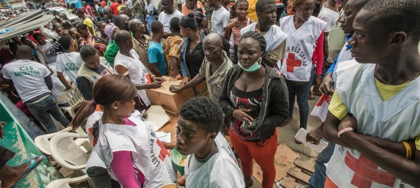 A WFP distribution centre in the heavily-populated West Point neighbourhood of Monrovia in Liberia, which was quarantined in response to the Ebola outbreak. Photo: WFP/Rein Skullerud
