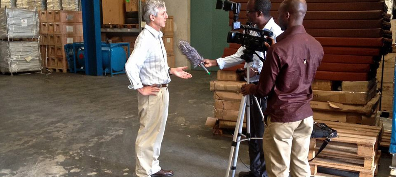 In the UN Humanitarian Response Depot (UNHRD) warehouse in Accra, Ghana, UNMEER's head, Anthony Banbury (left), spoke to some international media outlets on the latest developments in the Ebola Response. Photo: UNMEER