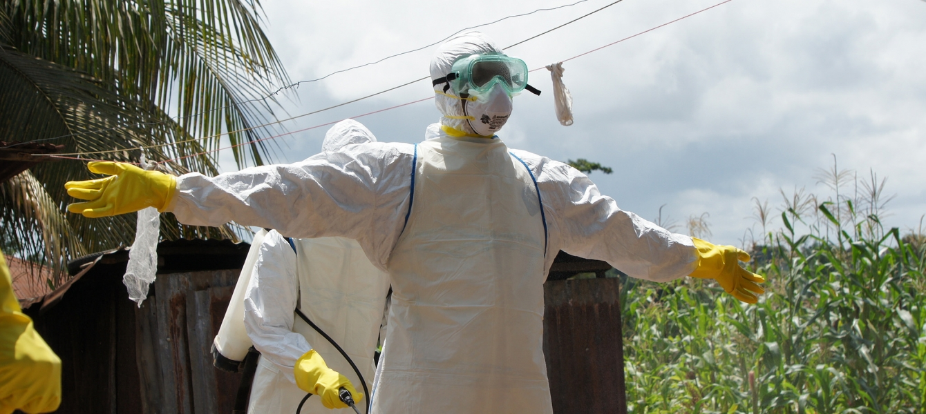 The Ebola burial team gets disinfected and can then remove their personal protective equipment safely.