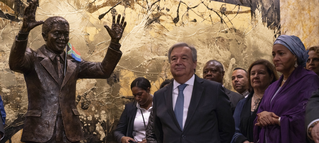 UN Secretary-General António Guterres (centre) next to the statue of Nelson Mandela gifted to the UN by South Africa.