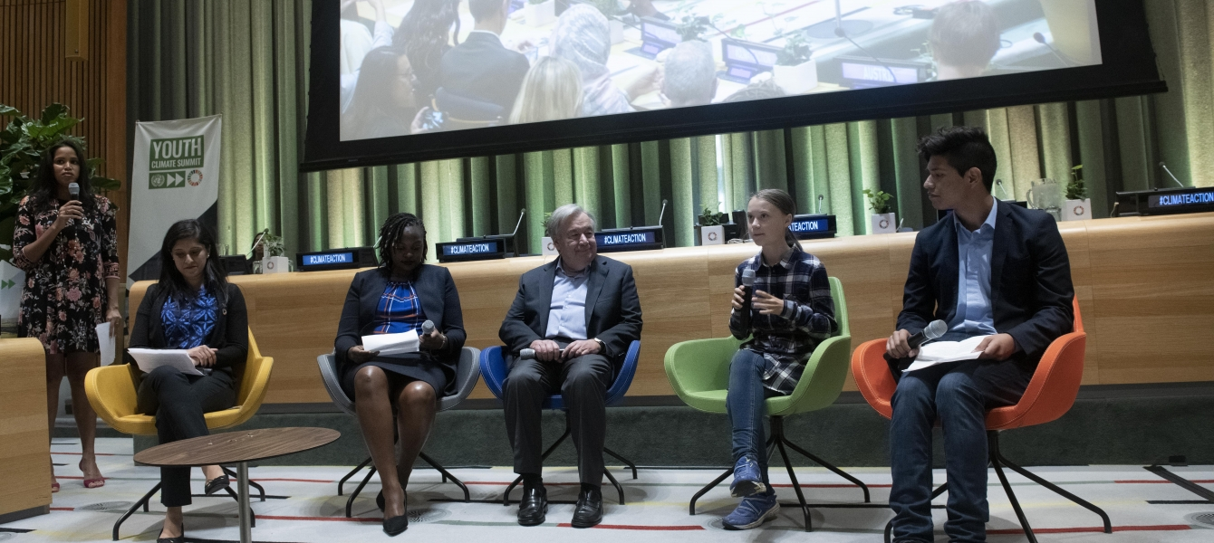Secretary-General António Guterres (centre) and Greta Thunberg (second from right), Youth Climate Activist, at the opening of the UN Youth Climate Summit.