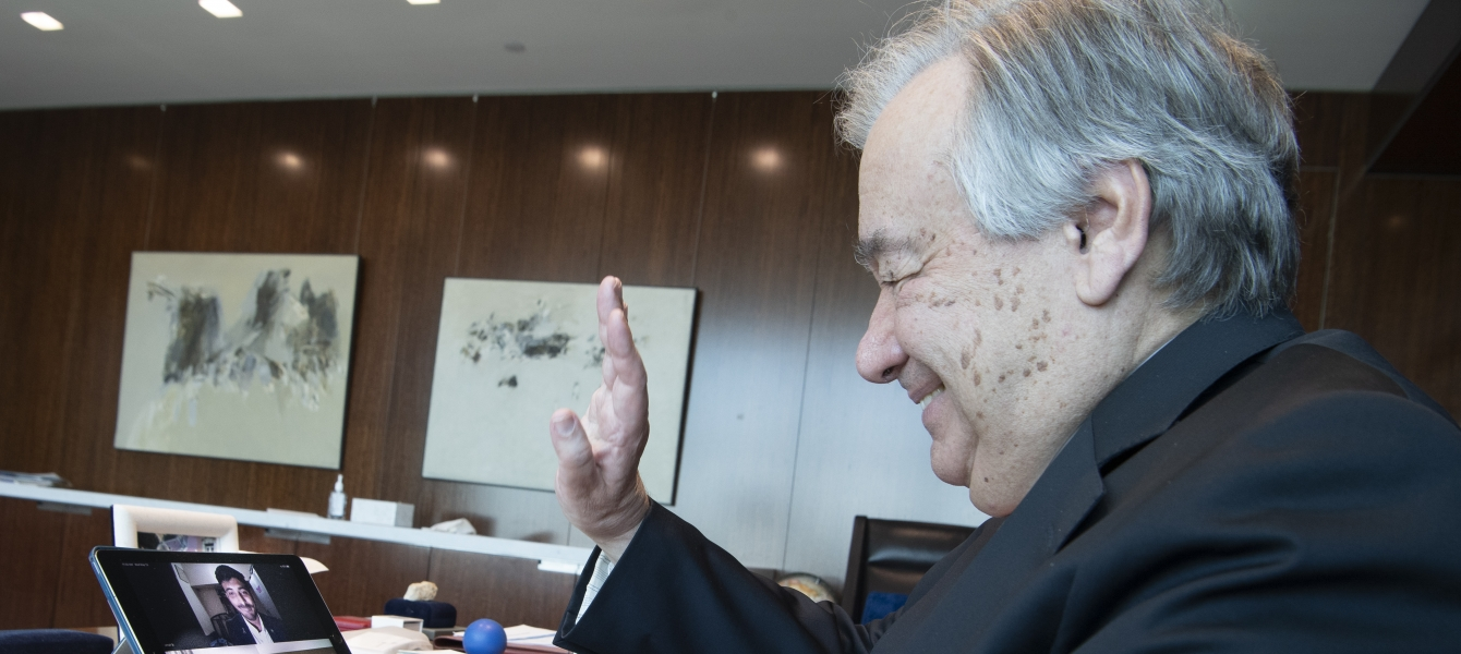 Secretary-General António Guterres in a three-way video call with frontline mental health workers, Mr. Umair Bachlani in Pakistan and Ms. Charlene Sunkel in South Africa. UN Photo/Eskinder Debebe