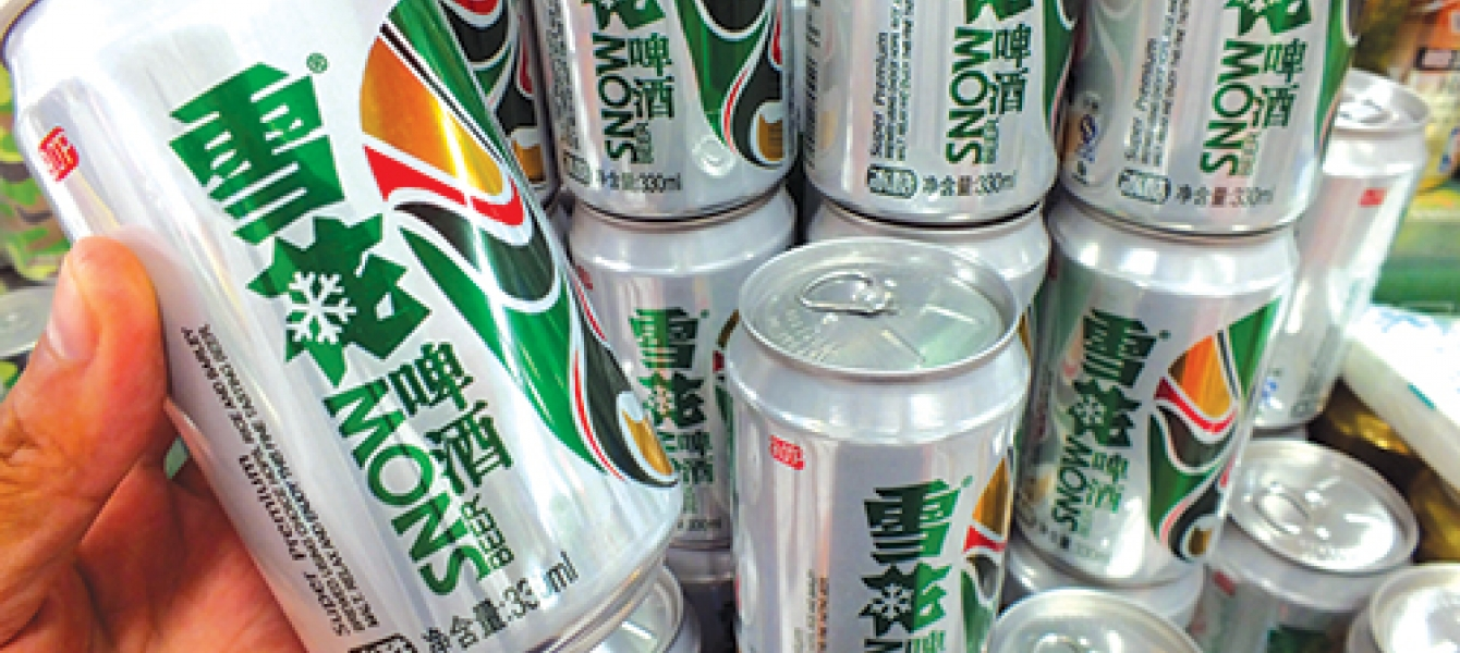 A shopper buys Snow beer at a supermarket in Yichang city, central Chinas Hubei province.AP Images /Yi chang