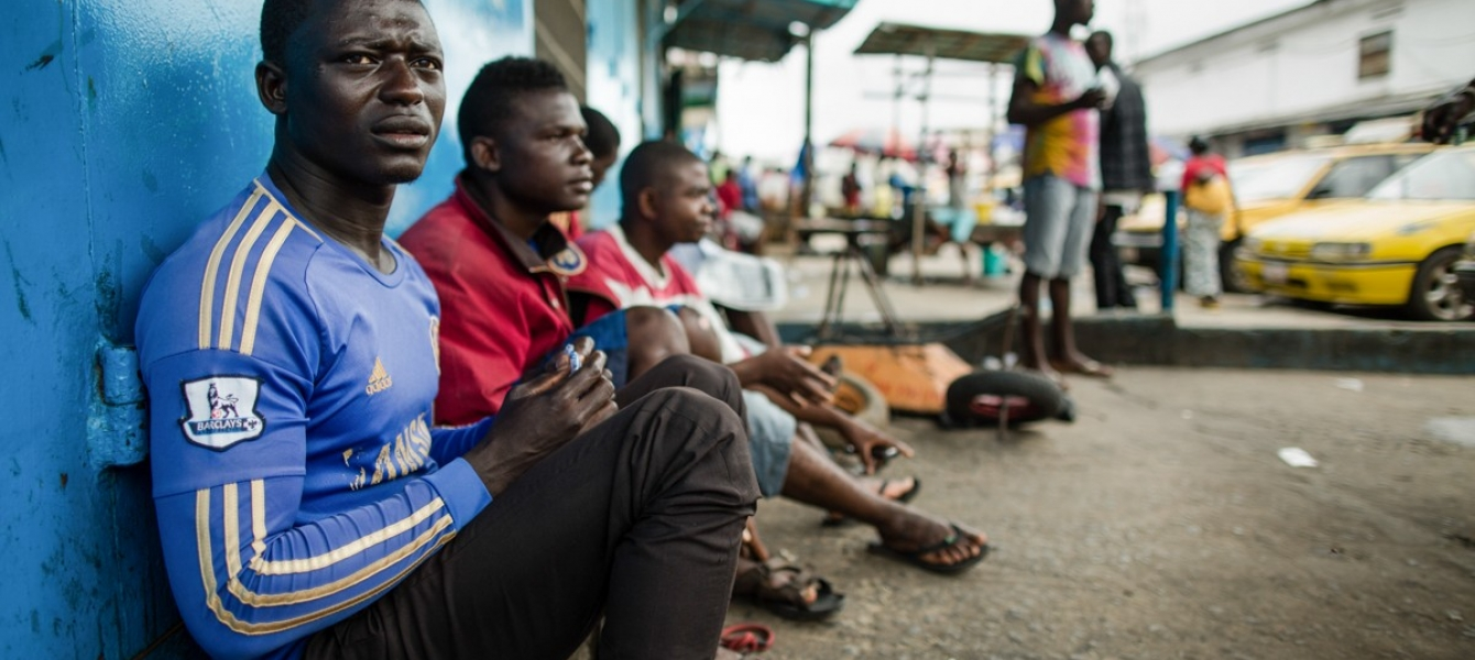 Unemployed taxi drivers during the Ebola crisis, Liberia 2014. The COVID-19 crisis threatens to disproportionately hit developing countries–Income losses are expected to exceed $220 billion.