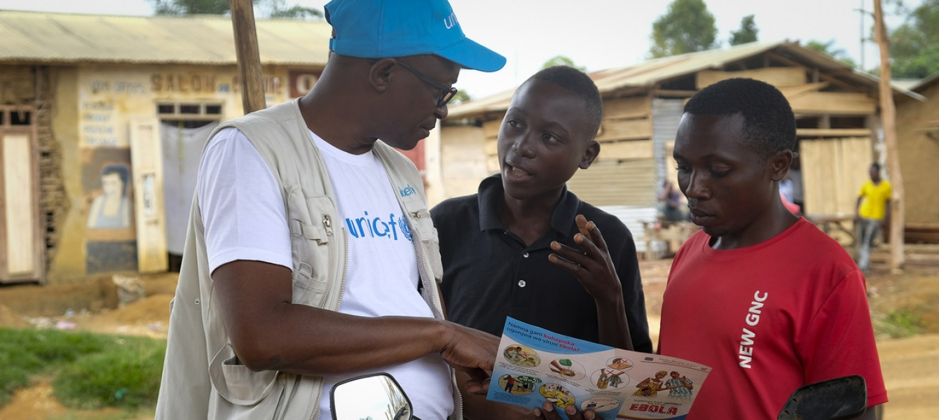 On 12 September 2018 in Beni, a UNICEF staff member discusses the best way to protect yourself against Ebola in a conversation with young people living in Beni, Democratic Republic of Congo, after a recent Ebola outbreak. Photo Credits: UNICEF/Thomas Nybo