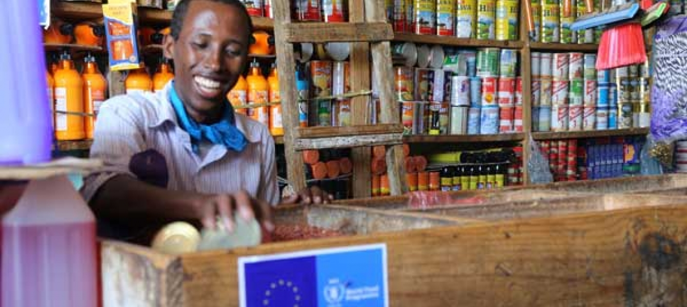 ​Retailers are embracing the system, because it brings them new customers who couldn't afford to buy food from shops before. Photo:WFP/Laila Ali