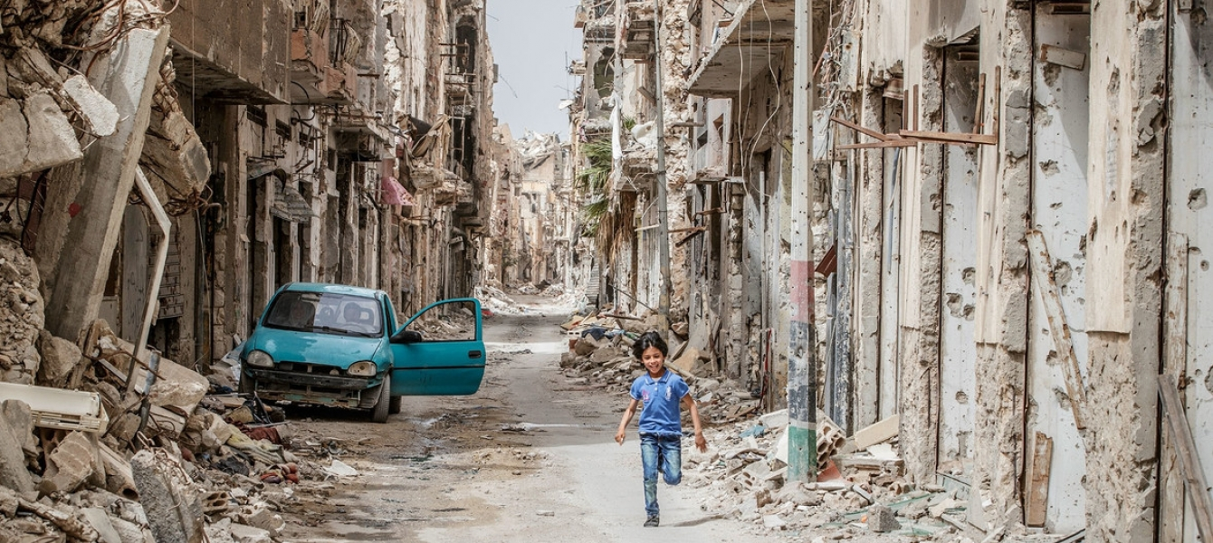A child runs through the debris and wreckage in downtown Benghazi, Libya.
