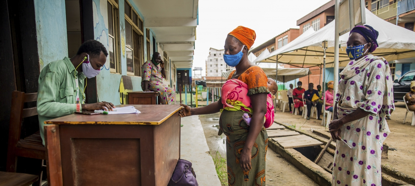 Women in Nigeria collect food vouchers as part of a programme to support families in difficulty under the Covid-19 lockdown.