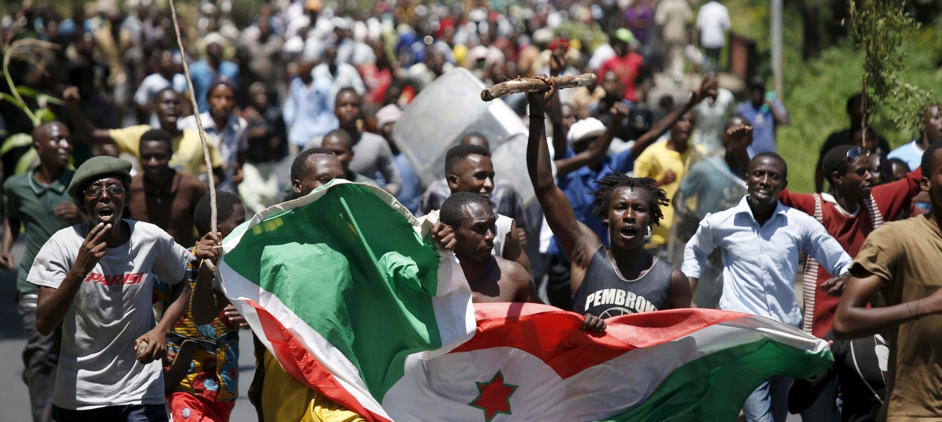 Demonstrators carry a Burundi flag during a protest in Bujumbura, Burundi. Photo: Reuters/G. Tomasevic