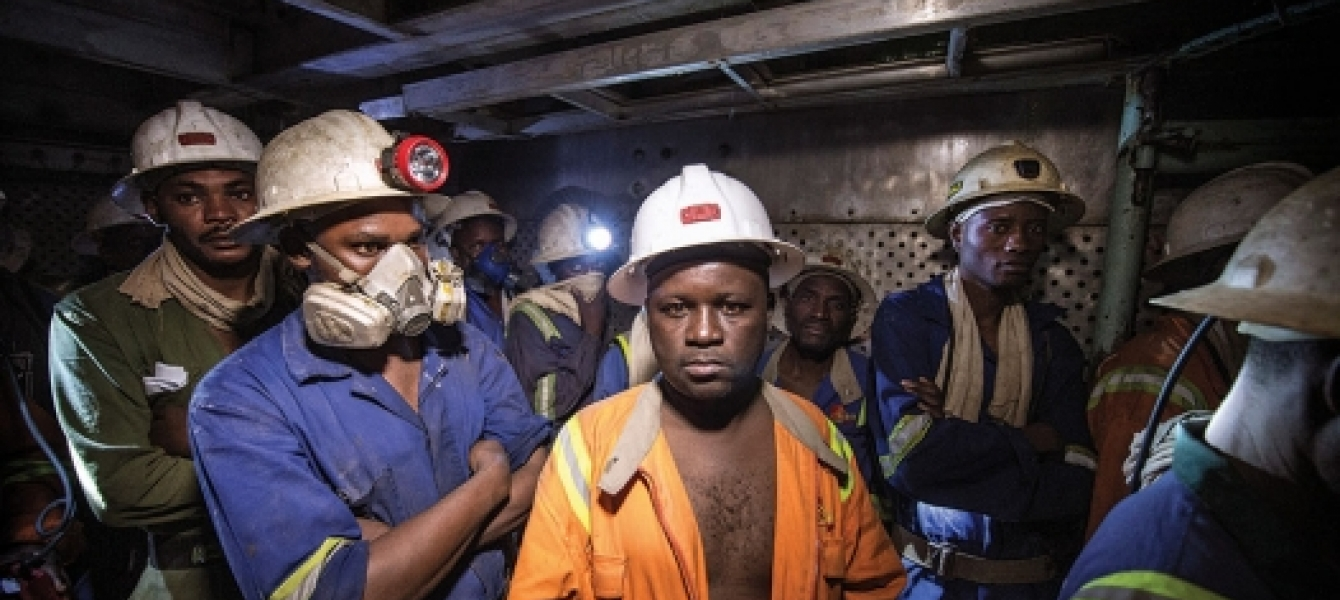 Miners in a lift cage at the Chambishi copper mine in Kitwe, Zambia. Photo: Panos/Sven Torfinn