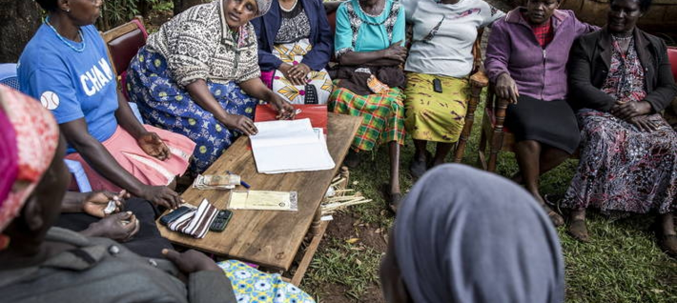 A Kenyan women farmers' group during one of their meetings. Working in a group ensures that the women can supply more crops, secure stable and good prices as well as share costs.