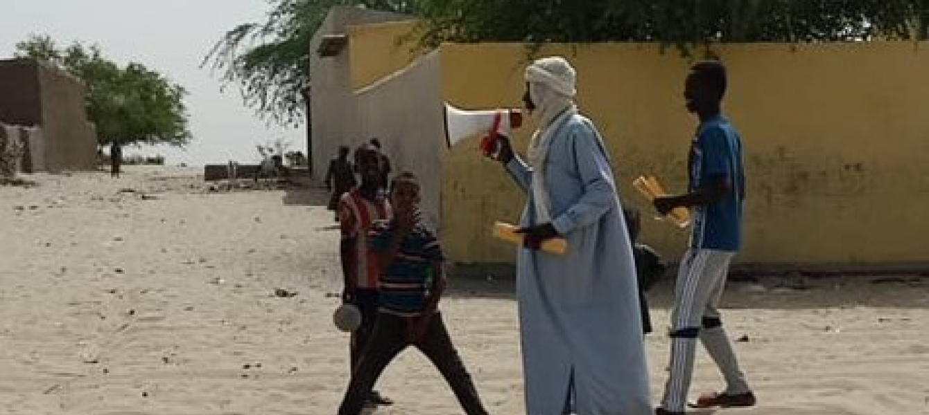 A town crier in Baga Sola (Lake Chad) informs communities in remote areas on the COVID-19.