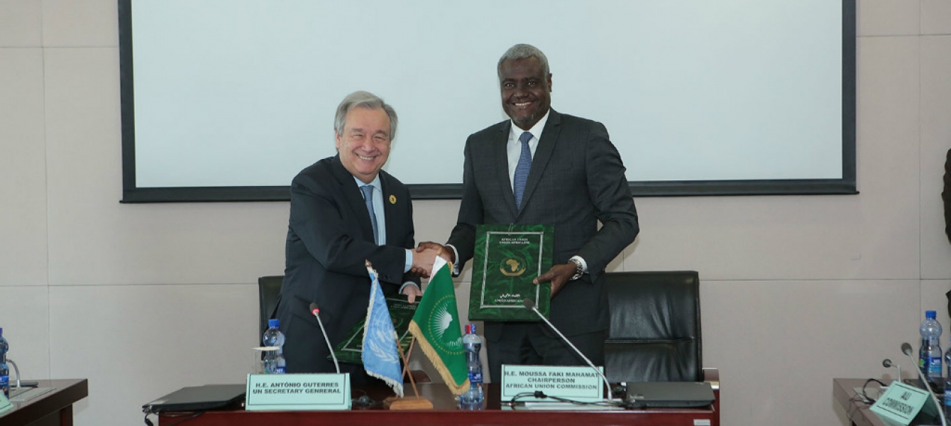 In Addis Ababa, Ethiopia, United Nations Secretary-General António Guterres and Moussa Faki, Chairperson of the African Union Commission, sign a Framework Agreement between the two organizations. UN Photo/Antonio Fiorente