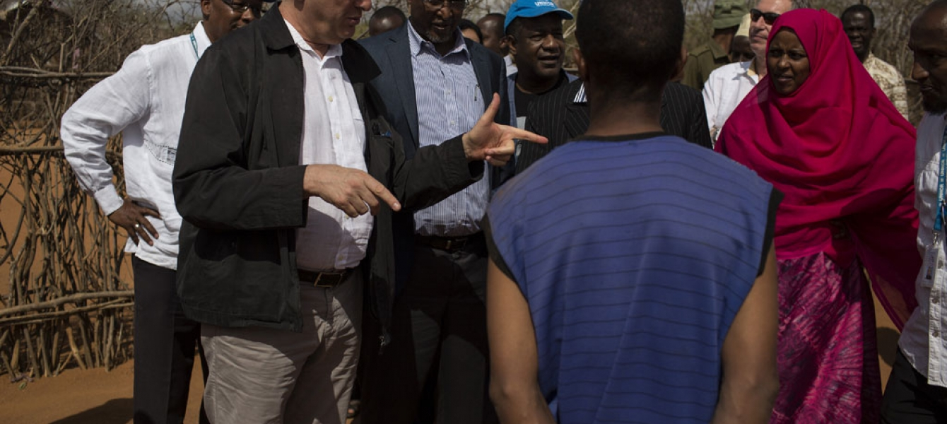 UN High Commissioner for Refugees Filippo Grandi talks to a Somali refugee family during his visit in Ifo Camp in Dadaab, Kenya. Photo: UNHCR/Siegfried Modola