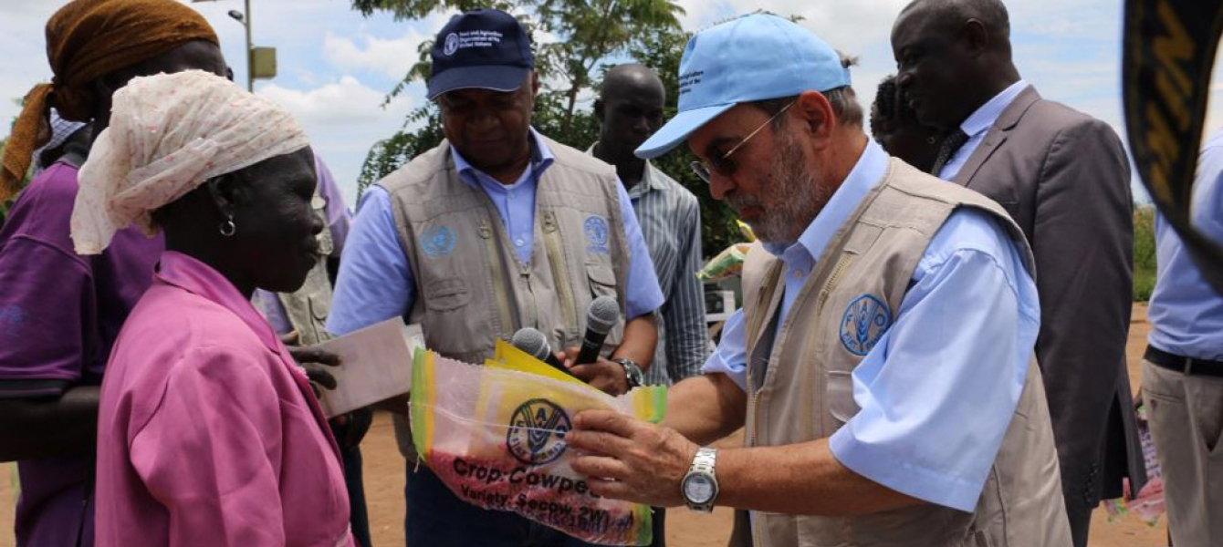 UN Food and Agriculture Organization (FAO) Director-General José Graziano da Silva in Uganda. Vegetable and crop seeds are provided to refugees to kick-start their food production. Photo: FAO/Anita Tibasaaga