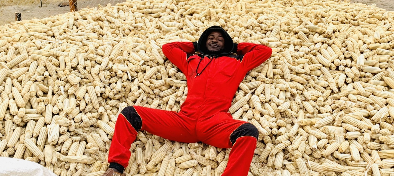 Terrence Maphosa with his maize harvest.