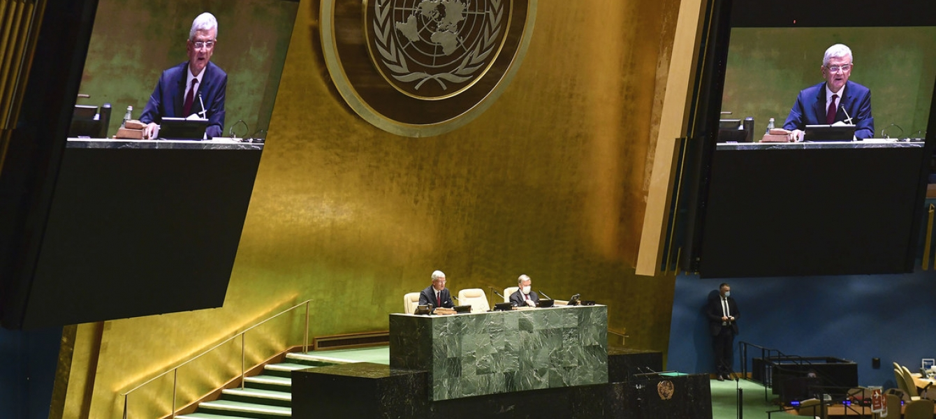 Volkan Bozkir (left at dais and on screens), President of the 75th session of the United Nations General Assembly, chairs the first plenary meeting of the 75th session of the General Assembly.