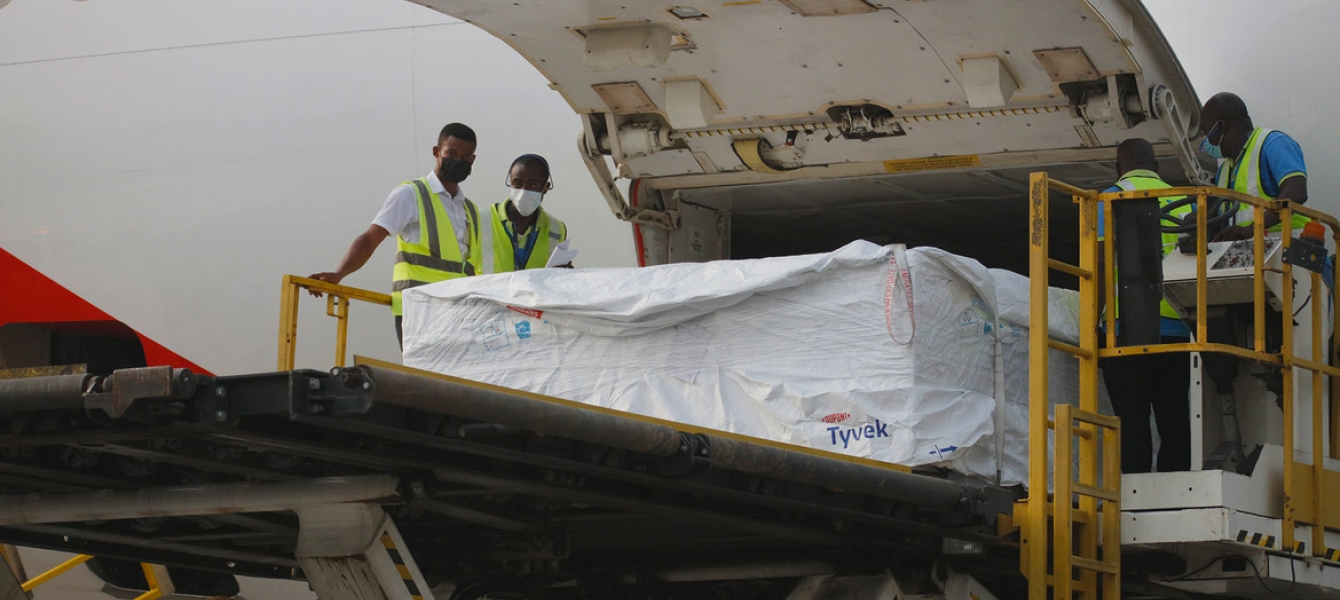 Staff unload the first shipment of COVID-19 vaccines distributed by COVAX at Kotoka International Airport in Accra, Ghana's capital.