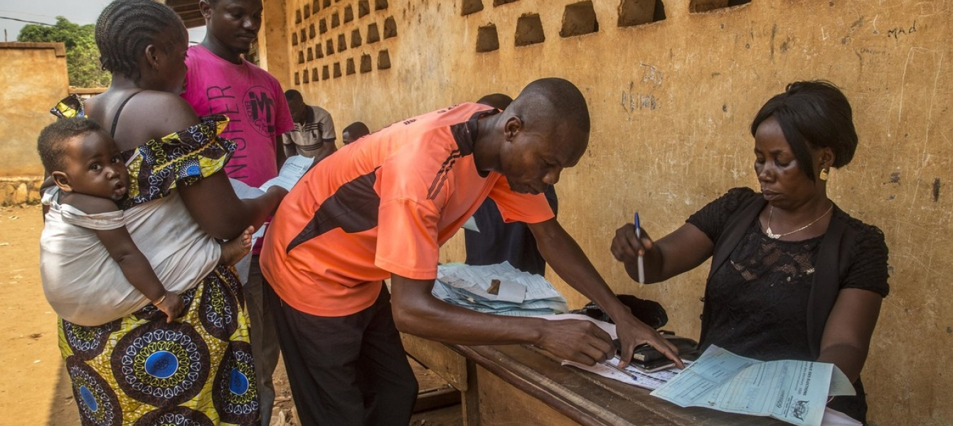 An official processes voter ID cards, ahead of the 27 December general elections in the Central African Republic.