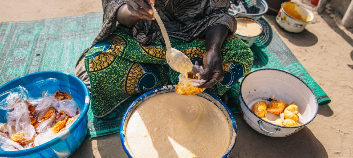 A woman prepares food at a camp for internally displaced persons