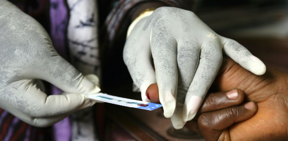 A woman has her blood taken for a test at a clinic in Freetown, Sierra Leone. Photo: Panos/ Giacomo Pirozzi