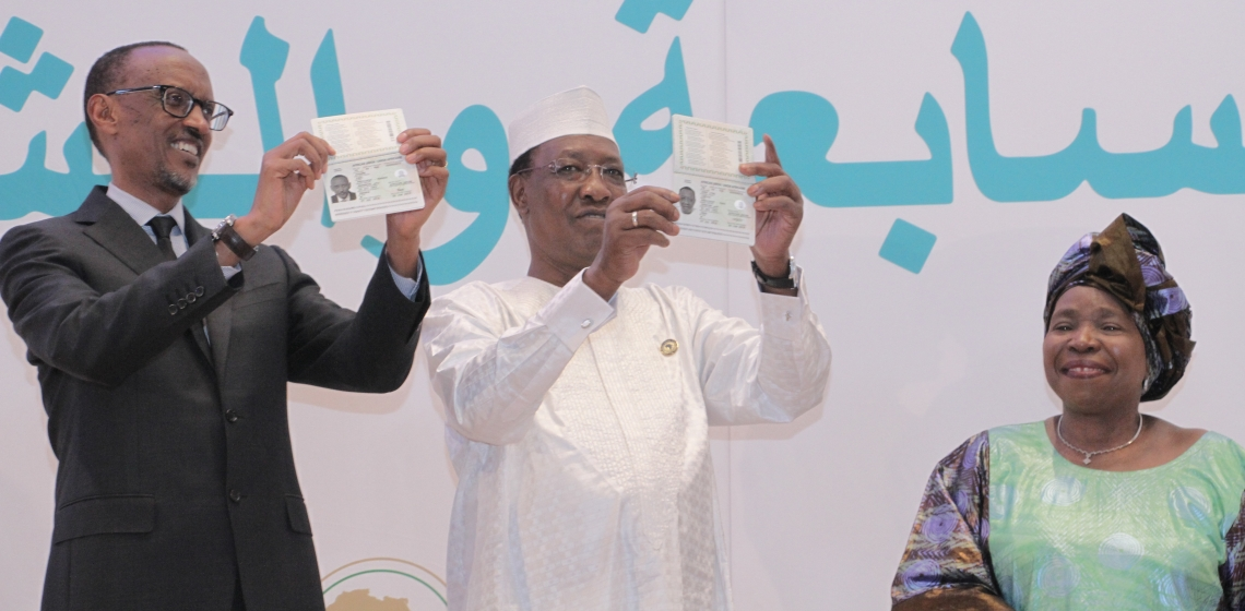Rwandan President Paul Kagame and Chadian President Idriss Déby, flanked by African Union Commission Chairperson Nkosazana Dlamini-Zuma, show off their new pan-African passports at the AU summit in Kigali in July 2016. Photo: African Union