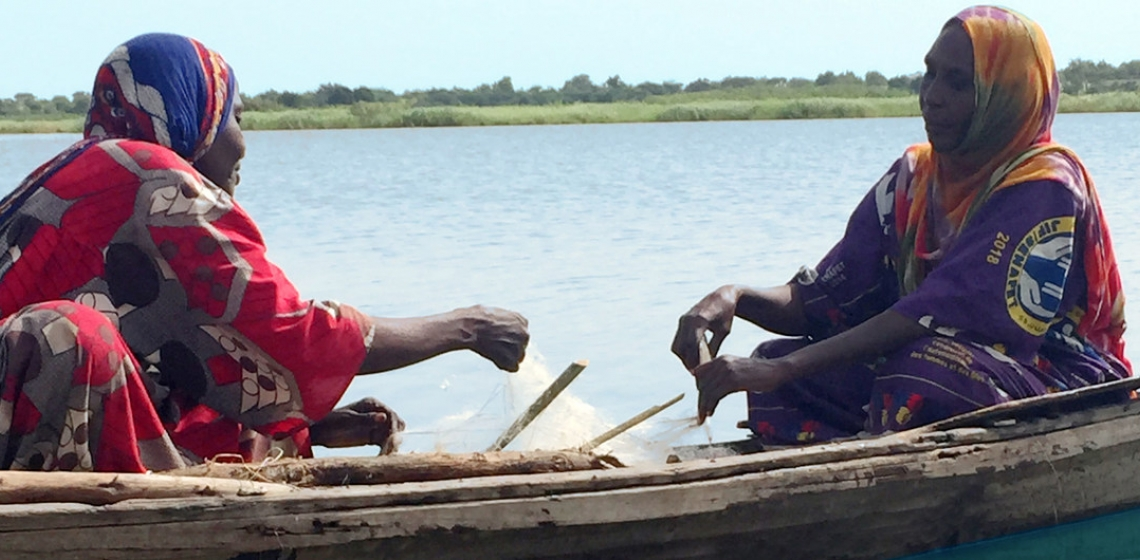 UN News/Dan Dickinson Fisherwomen like Falmata Mboh Ali (right) hard at work on Lake Chad, which has shrunk to a tenth of its original size over the past decades leaving dwindling stocks of fish.