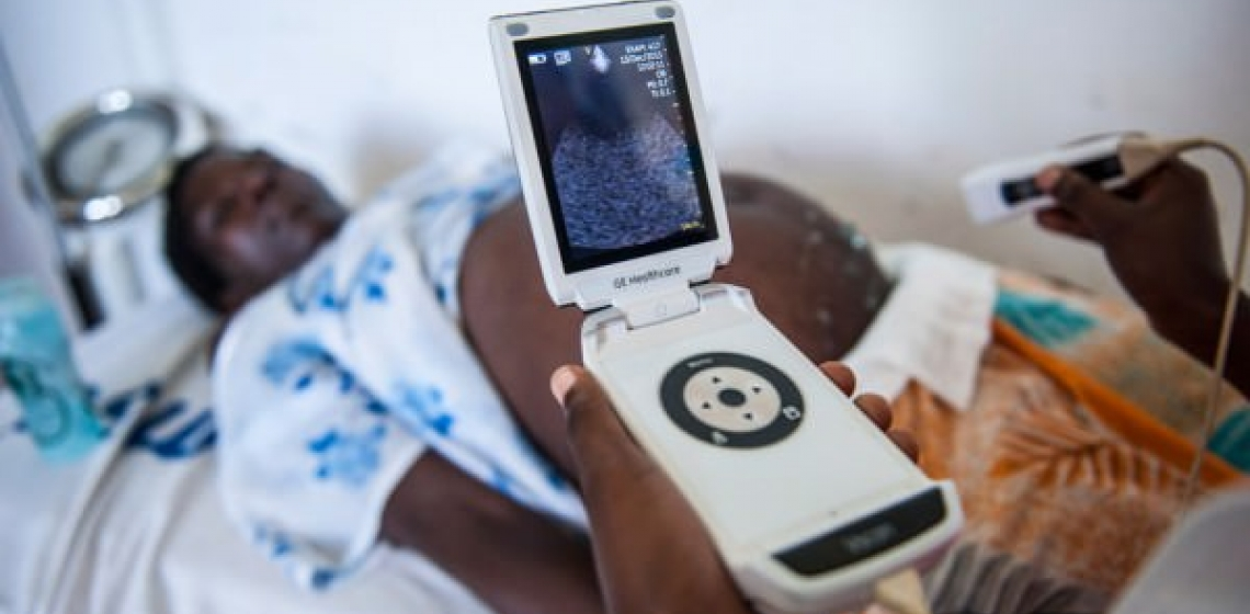 At the dispensary, Zaina can get an ultrasound examination, thanks to GE Healthcare's mobile Vscan ultrasound device. Photo credit:GE Sustainability