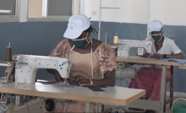 Young tailors in Guinea stitching masks