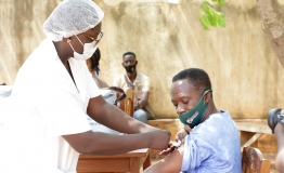 Man receiving COVID-19 vaccine.