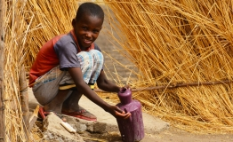 In Blue Nile State in Sudan a boy washes his hands in a village where UNICEF has been promoting good hygiene practices.