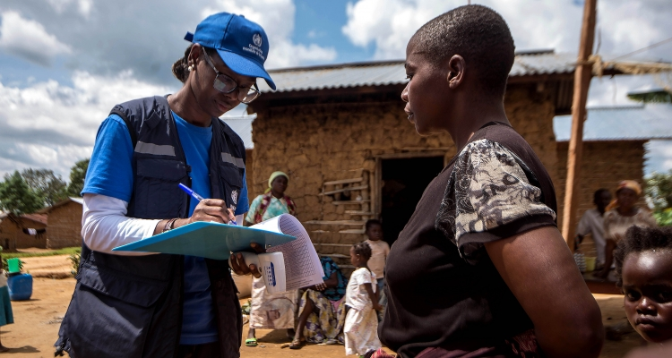 Marie-Roseline Bélizaire speaks to a woman as part of the contact tracing effort during an Ebola outbreak in eastern Democratic Republic of the Congo. Photo: WHO / J. Kannah.