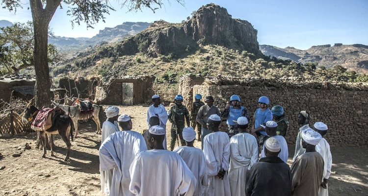 UNAMID peacekeepers interact with local community members during a routine patrol in Siri Sam village, near the Mission's temporary base in Golo, Central Darfur.