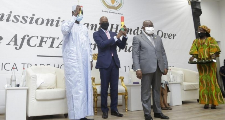 AU Commission Chairman Moussa Faki Mahamat (left), AfCFTA Secretary-General Wamkele Mene (centre) and Ghanaian President Nana Akufo-Addo (right) during the official commissioning and handover of the AfCFTA secretariat headquarters in Accra, Ghana.