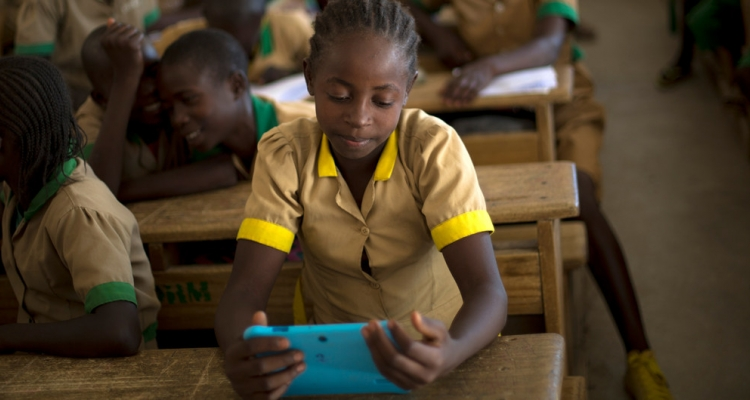 A student learns with the help of a computer tablet provided by UNICEF at a school in Baigai, northern Cameroon, Tuesday 31 October 2017.