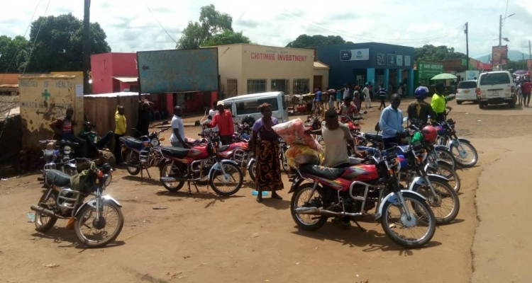 Motorcycle taxis at Lunzu town in Malawi. A good number of them are owned by women.