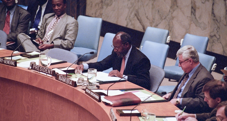 Martin Andjaba (Namibia), President of the Council, reads a statement on behalf of Council members. Seated right is Joseph Stephanides, Director of the Security Council Affairs Division of the Department of Political Affairs.