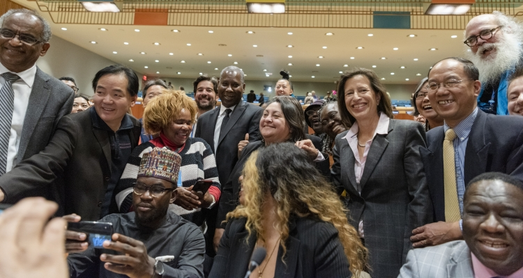 Tijjani Muhammad-Bande, President of the 74th session of the United Nations General Assembly (centre) and Melissa Fleming, Under-Secretary-General for Global Communications (fourth from right), pose with representatives of civil society following a conver