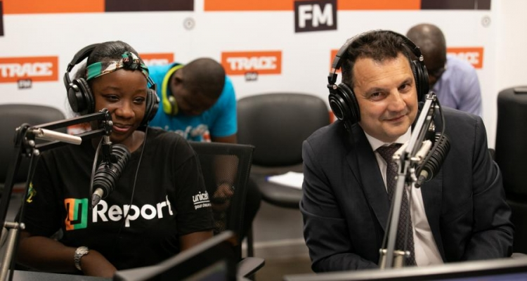 "Caption: Resident Coordinator, Philippe Poinsot, and youth are guests on ""Generation 2.0"" on Trace FM.  Photo: UNICEF Côte d'Ivoire/Milequem Diarrassouba"