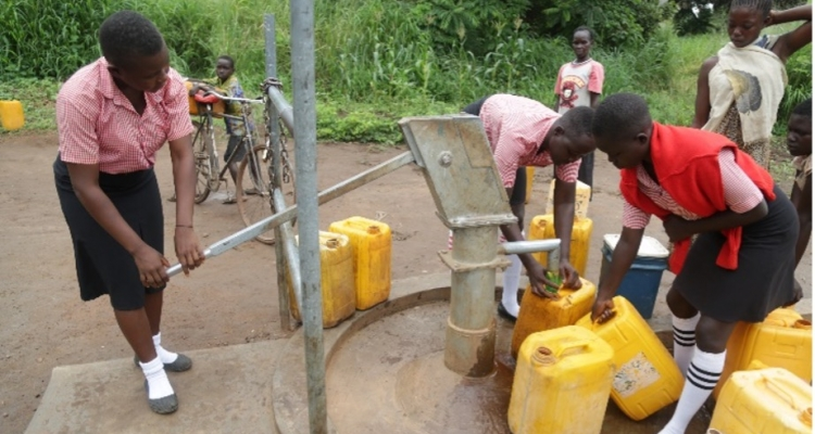 An image of Maridi students of the Girls Boarding Secondary School at one of the borehole.