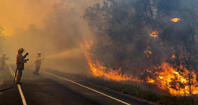Firefighters in Queensland, Australia, tackle a blaze which is threatening local communities.