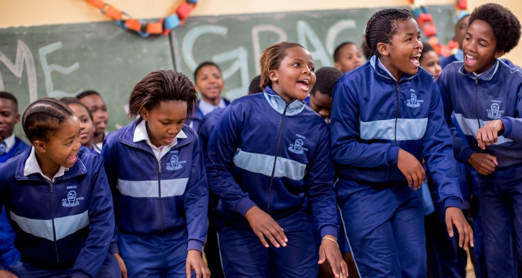 South African school girls from the United Nations Trust Fund (UNTF) - supported Grassroot Soccer SKILLZ Street intervention at the Yomelela Primary School in Khayalitsha, the largest informal township in Cape Town South Africa.