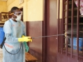 A volunteer disinfecting the hospital of Tahouay in Conakry, Guinea.  Photo: Afreecom/Idrissa Soumaré