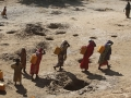 Women carry jerry cans of water from shallow wells dug from the sand along the Shabelle River bed, following a drought in Somalia. Photo: Reuters/Feisal Omar