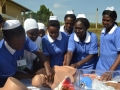 Trainee midwives demonstrating the childbirth process using a birth simulator in Kampala, Uganda.  Photo: UNFPA/Evelyn Kiapi