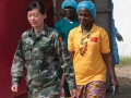 Beatrice Yardolo, right, Liberia's last Ebola patient, walks out of the Chinese Ebola Treatment Unit (ETU) in Monrovia, Liberia, at the beginning of a short ceremony celebrating her survival and release from the ETU on March 5.Photo:UNMEER/Simon Ruf